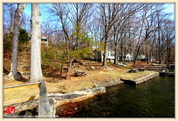 Enjoy fishing and boating in the lovely lake that is just meters away from this relaxing and charming home for sale in Danbury CT.